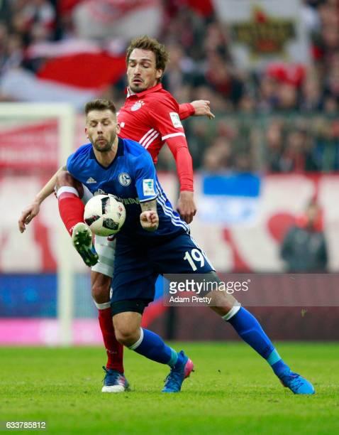 Mats Hummels of Muenchen and Guido Burgstaller of Schalke battle for the ball during the Bundesliga match between Bayern Muenchen and FC Schalke 04...