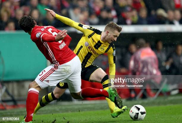Mats Hummels of Muenchen and Marco Reus of Dortmund battle for the ball during the DFB Cup semi final match between FC Bayern Muenchen and Borussia...