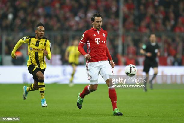 Mats Hummels of Muenchen balltels for the ball with PierreEmerick Aubameyang of Dortmund during the DFB Cup semi final match between FC Bayern...