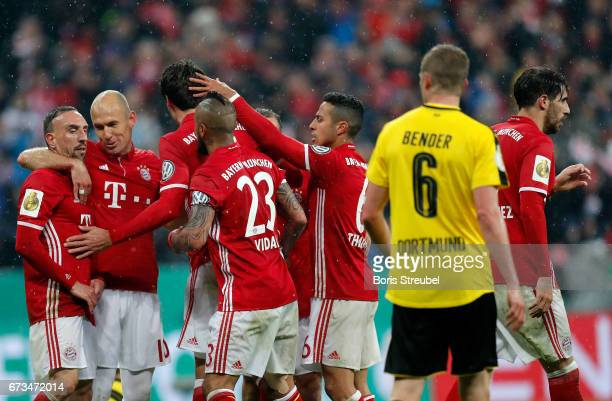 Mats Hummels of Muenchen celebrate with his team mates after he scores the 2nd goal during the DFB Cup semi final match between FC Bayern Muenchen...