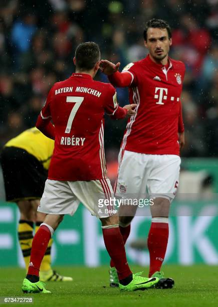 Mats Hummels of Muenchen celebrate with team mate Franck Ribery after he scores the 2nd goal during the DFB Cup semi final match between FC Bayern...