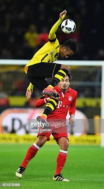 Mats Hummels of Muenchen is challenged by PierreEmerick Aubameyang of Dortmund during the Bundesliga match between Borussia Dortmund and Bayern...