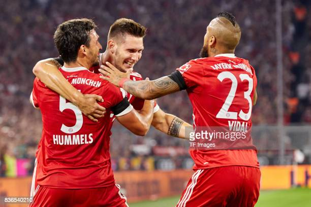 Mats Hummels of Muenchen Niklas Suele of Muenchen and Arturo Vidal of Muenchen celebrate a goal during the Bundesliga match between FC Bayern...