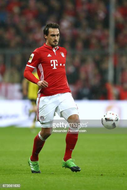 Mats Hummels of Muenchen runs with the ball during the DFB Cup semi final match between FC Bayern Muenchen and Borussia Dortmund at Allianz Arena on...