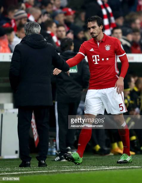 Mats Hummels of Muenchen shake hand with head coach Carlo Ancelotti of Dortmund during the DFB Cup semi final match between FC Bayern Muenchen and...