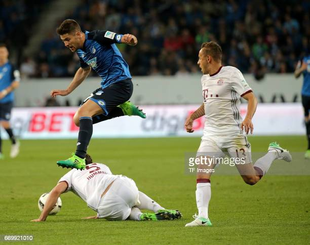 Mats Hummels of Munich and Andrej Kramaric of Hoffenheim and Rafinha of Munich battle for the ball during the Bundesliga match between TSG 1899...