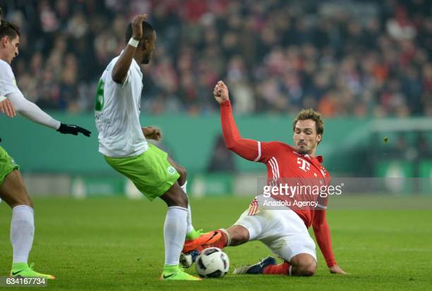 Mats Hummels of Munich and Riechedly Bazoer of Wolfsburg vie for the ball during the DFB Cup soccer match between FC Bayern Munich and VfL Wolfsburg...