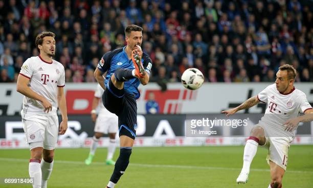 Mats Hummels of Munich and Sandro Wagner of Hoffenheim and Rafinha of Munich battle for the ball during the Bundesliga match between TSG 1899...