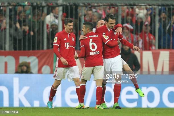 Mats Hummels of Munich celebrates with teammates after scoring during the German Cup semi final soccer match between FC Bayern Munich and Borussia...