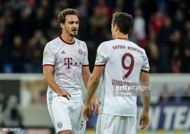 Mats Hummels of Munich Robert Lewandowski of Munich looks dejected during the Bundesliga match between TSG 1899 Hoffenheim and Bayern Muenchen at...