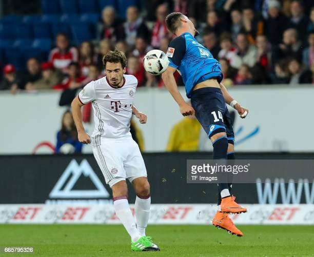 Mats Hummels of Munich und Sandro Wagner of Hoffenheim battle for the ball during the Bundesliga match between TSG 1899 Hoffenheim and Bayern...