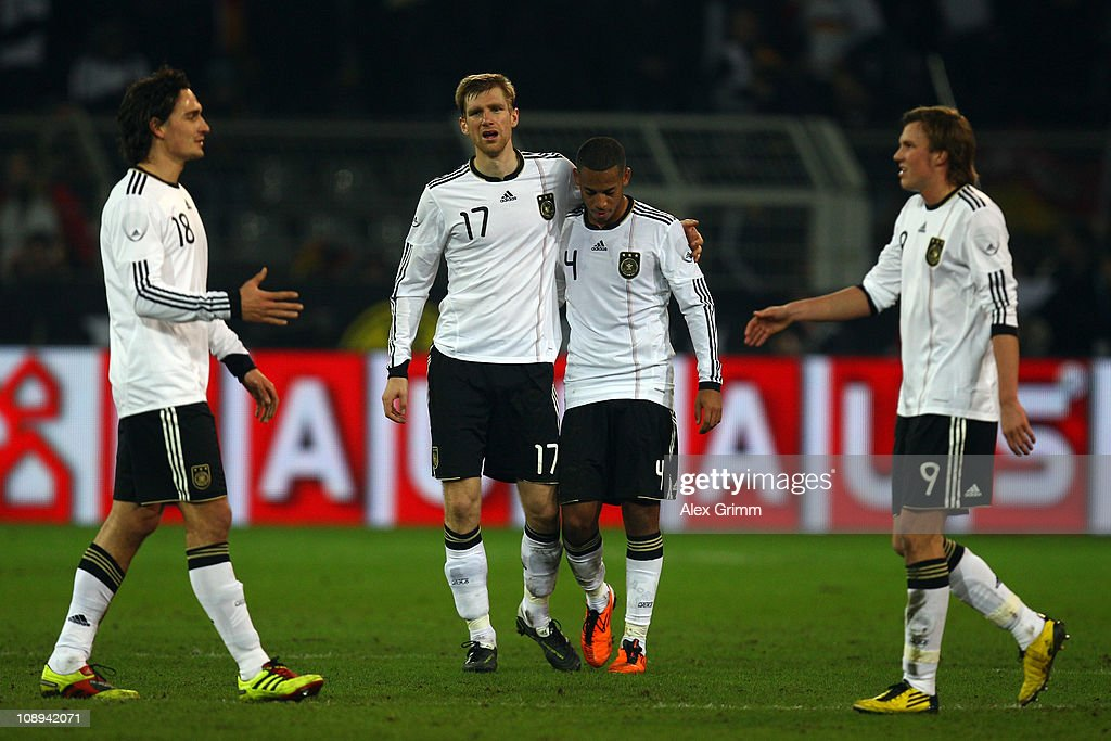 Mats Hummels, Per Mertesacker, Dennis Aogo and Kevin Grosskreutz (L-R) react after the international friendly match between Germany and Italy at Signal Iduna Park on February 9, 2011 in Dortmund, Germany.