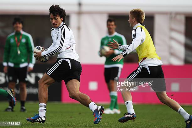 Mats Hummels runs with a Rugby ball during a Germany training session at stadium Tourette on May 19 2012 in Tourrettes sur Loup France