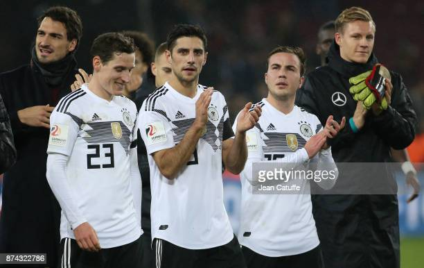 Mats Hummels Sebastian Rudy Lars Stindl Mario Goetze Marc Andre ter Stegen of Germany salute the fans following the international friendly match...