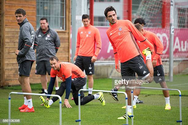 Mats Hummels stretches during a training session of FC Bayern Muenchen on August 5 2016 in Munich Germany