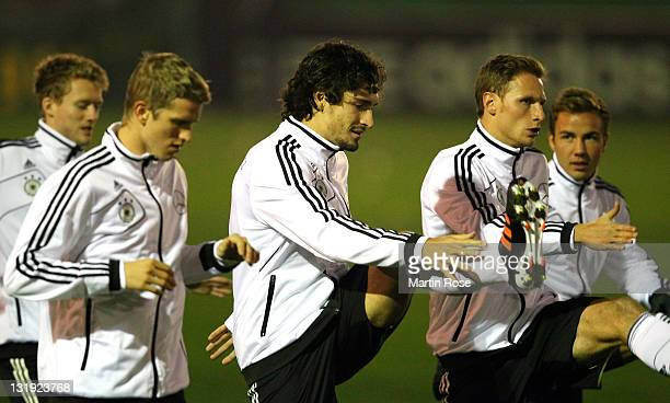 Mats Hummels stretches during the German National team training session at Victoria stadium on November 8 2011 in Hamburg Germany