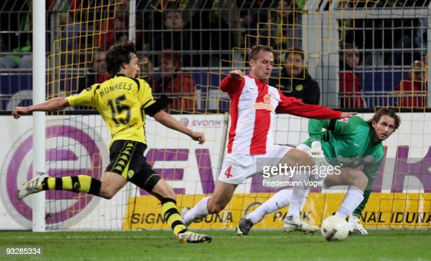 Mats Julian Hummels of Dortmund in action with Nikolce Noveski and Heinz Mueller of Mainz during the Bundesliga match between Borussia Dortmund and...