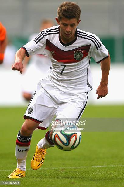 Mats Koehlert of Germany runs with the ball during the KOMM MIT tournament match between U17 Germany and U17 Netherlands at Audi Sportpark on...