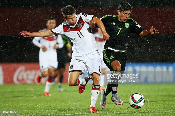 Mats Kohlert of Germany and Kevin Lara of Mexico vie for control of the ball during the FIFA U17 World Cup Chile 2015 Group C match between Germany...