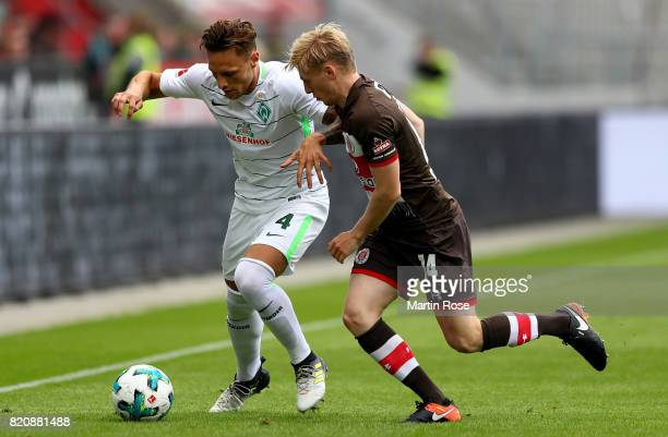 Mats Moeller Daehli of St Pauli and Robert Bauer of Bremen battle for the ball during the preseason friendly match between FC St Pauli and Werder...