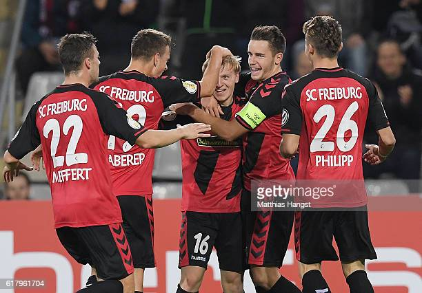 Mats Moller Daehli of Freiburg celebrates with his teammates after scoring his team's first goal during the DFB Cup match between SC Freiburg and SV...
