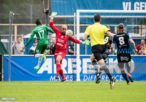 Mats Solheim of Hammarby IF shoots and Lukas Jonsson goalkeepeer of IK Sirius FK saves during the Allsvenskan match between IK Sirius FK and Hammarby...