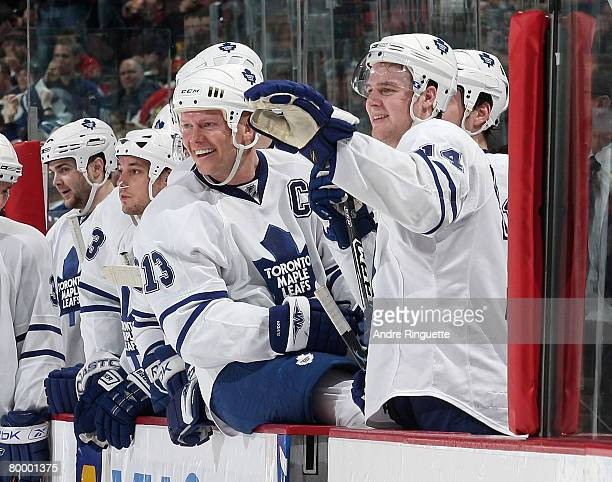 Mats Sundin and Matt Stajan of the Toronto Maple Leafs smile from the bench after a goal against the Ottawa Senators at Scotiabank Place on February...