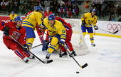 Mats Sundin of Sweden fights for the puck with Petr Cajanek of Czech Republic during the semi final of the men's ice hockey match between Sweden and...