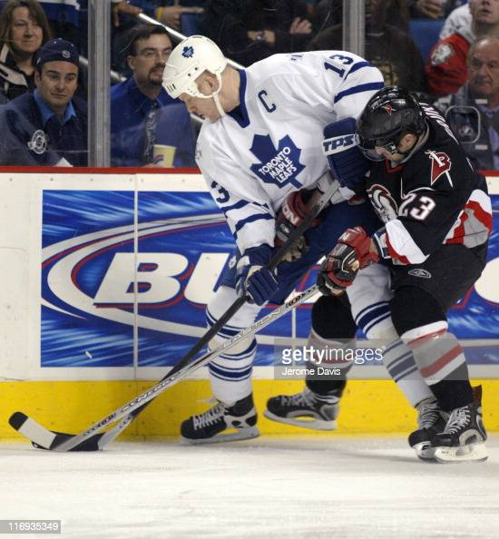 Mats Sundin of the Toronto Maple Leafs battles with Chris Drury of the Buffalo Sabres during a game at the HSBC Arena in Buffalo New York March 16...