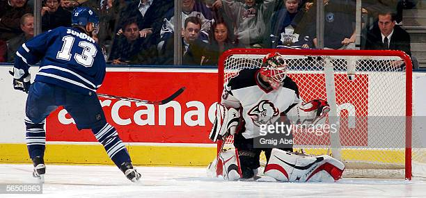 Mats Sundin of the Toronto Maple Leafs scores in the shoot out on Martin Biron of the Buffalo Sabres during the NHL game at Air Canada Centre...