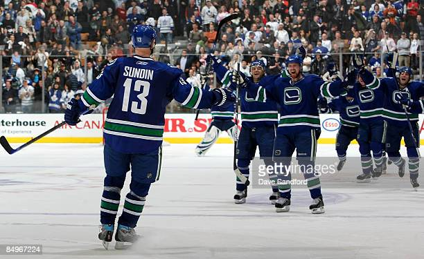 Mats Sundin of the Vancouver Canucks celebrates his shootout winning goal against his former team the Toronto Maple Leafs during their NHL game at...