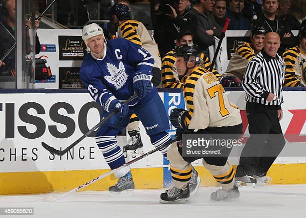 Mats Sundin passes the puck past Paul Coffey during the Hockey Hall of Fame Legends Classic Game at the Air Canada Centre on November 16 2014 in...