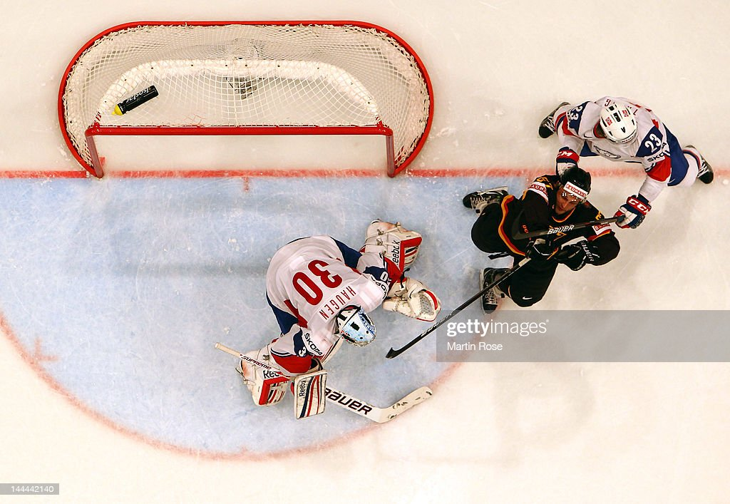 Mats Trygg (R) of Norway holds Christoph Ullmann (C) of Germany during the IIHF World Championship group S match between Germany and Norway at Ericsson Globe on May 13, 2012 in Stockholm, Sweden.