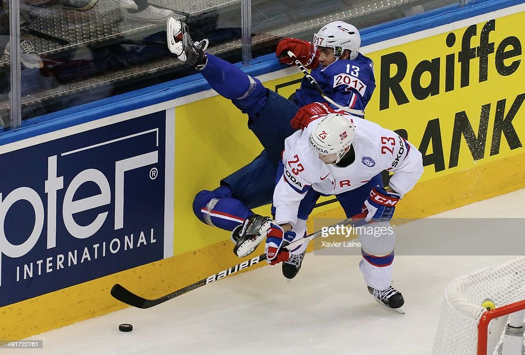 Mats Trygg of Norway slashed Luc Tardif of France during the 2014 IIHF World Championship between France and Norway at Chizhovka arena on may 17,2014 in Minsk, Belarus.