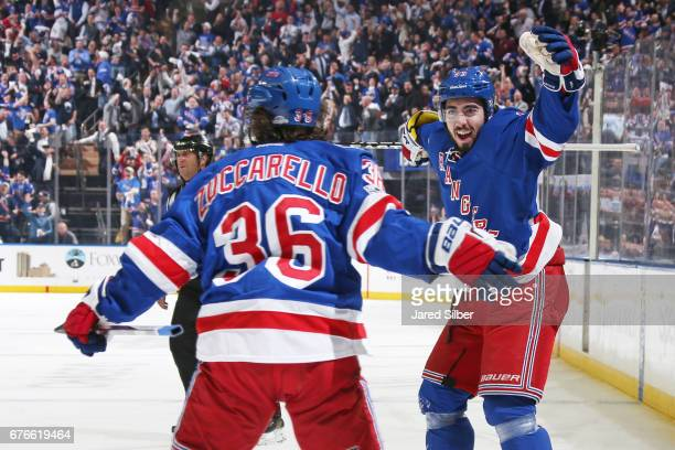 Mats Zuccarello and Mika Zibanejad of the New York Rangers celebrate after scoring a goal in the first period against the Ottawa Senators in Game...