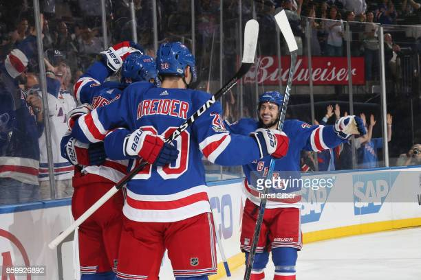 Mats Zuccarello Chris Kreider and Mika Zibanejad of the New York Rangers celebrate after scoring a goal in the first period against the St Louis...