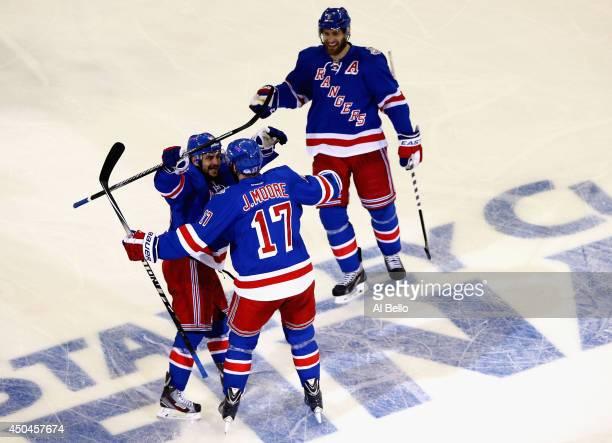 Mats Zuccarello Dan Girardi and John Moore of the New York Rangers celebrate a goal by Benoit Pouliot of the New York Rangers on Jonathan Quick of...