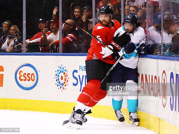 Mats Zuccarello of Team Europe is checked into the boards by Shea Weber of Team Canada during the first period during Game One of the World Cup of...