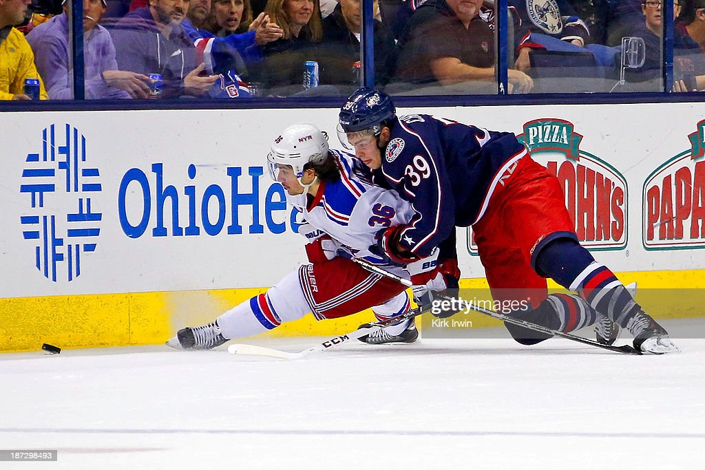 <a gi-track='captionPersonalityLinkClicked' href=/galleries/search?phrase=Mats+Zuccarello&family=editorial&specificpeople=7219903 ng-click='$event.stopPropagation()'>Mats Zuccarello</a> #36 of the New York Rangers and Michael Chaput #39 of the Columbus Blue Jackets battle for control of the puck during the third period on November 7, 2013 at Nationwide Arena in Columbus, Ohio. New York defeated Columbus 4-2.
