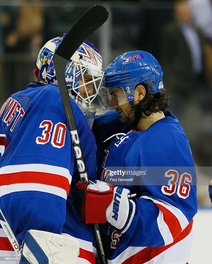 <a gi-track='captionPersonalityLinkClicked' href=/galleries/search?phrase=Mats+Zuccarello&family=editorial&specificpeople=7219903 ng-click='$event.stopPropagation()'>Mats Zuccarello</a> #36 of the New York Rangers butt helmets with teammate <a gi-track='captionPersonalityLinkClicked' href=/galleries/search?phrase=Henrik+Lundqvist&family=editorial&specificpeople=217958 ng-click='$event.stopPropagation()'>Henrik Lundqvist</a> #30 after the Rangers shut out the Buffalo Sabres 2-0 in an NHL hockey game at Madison Square Garden on October 31, 2013 in New York City.