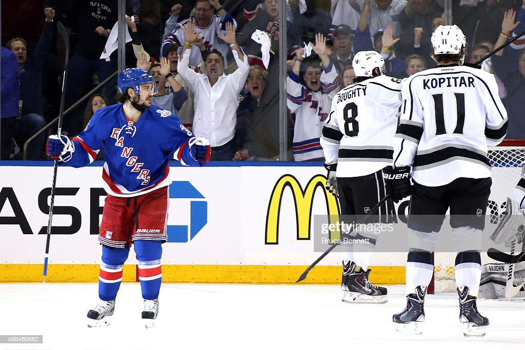 Mats Zuccarello #36 of the New York Rangers celebrates a goal by Benoit Pouliot #67 of the New York Rangers on Jonathan Quick #32 of the Los Angeles Kings during the first period of Game Four of the 2014 NHL Stanley Cup Final at Madison Square Garden on June 11, 2014 in New York, New York.