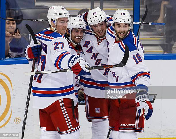 Mats Zuccarello of the New York Rangers celebrates his goal with teammates JT Miller Ryan McDonagh Derick Brassard against the Tampa Bay Lightning...