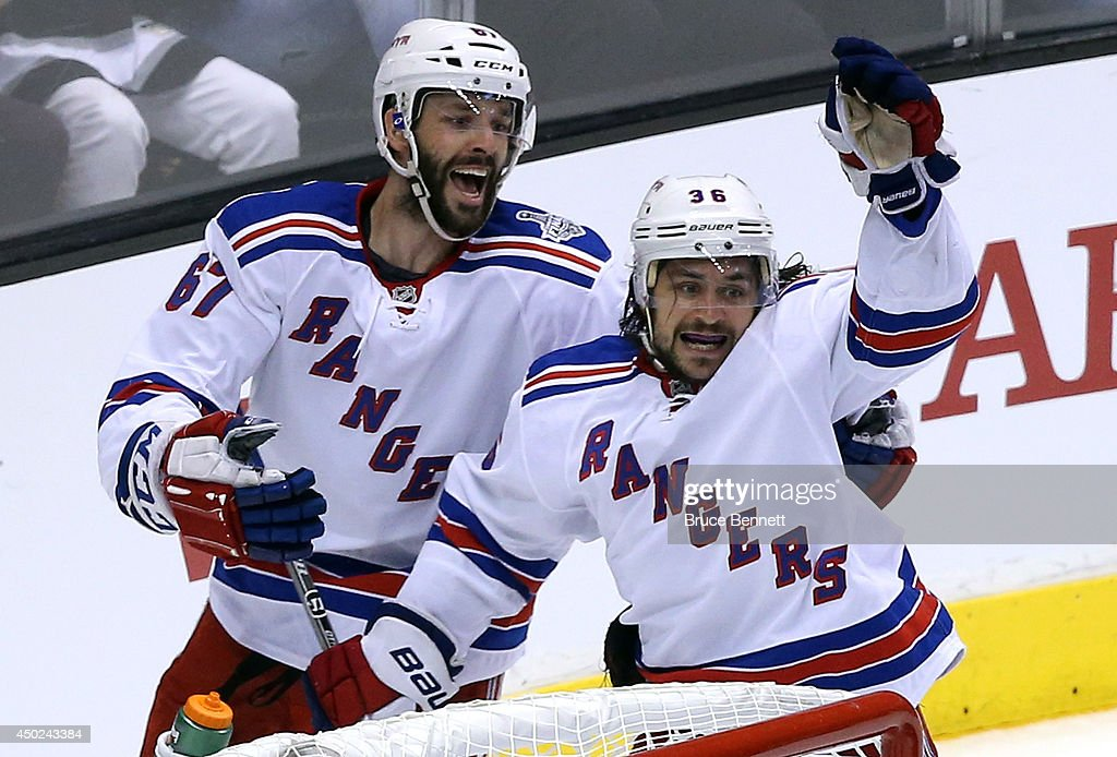 <a gi-track='captionPersonalityLinkClicked' href=/galleries/search?phrase=Mats+Zuccarello&family=editorial&specificpeople=7219903 ng-click='$event.stopPropagation()'>Mats Zuccarello</a> #36 of the New York Rangers celebrates his goal with teammate <a gi-track='captionPersonalityLinkClicked' href=/galleries/search?phrase=Benoit+Pouliot&family=editorial&specificpeople=879830 ng-click='$event.stopPropagation()'>Benoit Pouliot</a> #67 in the first period during Game Two of the 2014 NHL Stanley Cup Final at the Staples Center on June 7, 2014 in Los Angeles, California.