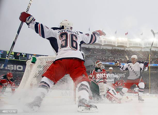 Mats Zuccarello of the New York Rangers celebrates his second period goal against the New Jersey Devils during the 2014 Coors Light NHL Stadium...