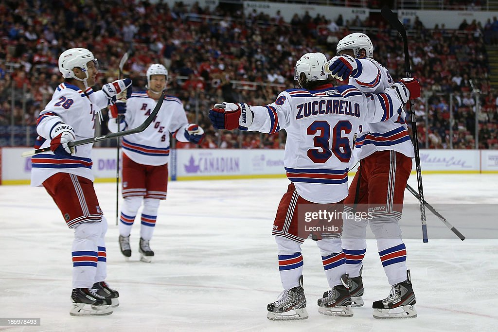 <a gi-track='captionPersonalityLinkClicked' href=/galleries/search?phrase=Mats+Zuccarello&family=editorial&specificpeople=7219903 ng-click='$event.stopPropagation()'>Mats Zuccarello</a> #36 of the New York Rangers celebrates with his teammates after scoring a goal during the third period of the game against Detroit Red Wings at Joe Louis Arena on October 26, 2013 in Detroit, Michigan. The Rangers defeated the Red Wings 3-2.