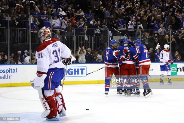 Mats Zuccarello of the New York Rangers celebrates with his teammates after scoring his second goal against Carey Price of the Montreal Canadiens...
