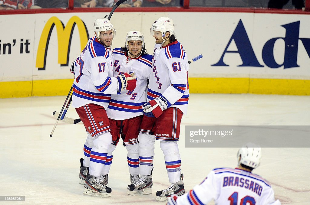 <a gi-track='captionPersonalityLinkClicked' href=/galleries/search?phrase=Mats+Zuccarello&family=editorial&specificpeople=7219903 ng-click='$event.stopPropagation()'>Mats Zuccarello</a> #36 of the New York Rangers celebrates with John Moore #17 and <a gi-track='captionPersonalityLinkClicked' href=/galleries/search?phrase=Rick+Nash&family=editorial&specificpeople=202196 ng-click='$event.stopPropagation()'>Rick Nash</a> #61 after scoring in the third period against the Washington Capitals in Game Seven of the Eastern Conference Quarterfinals during the 2013 NHL Stanley Cup Playoffs at the Verizon Center on May 13, 2013 in Washington, DC. New York won the game 5-0.