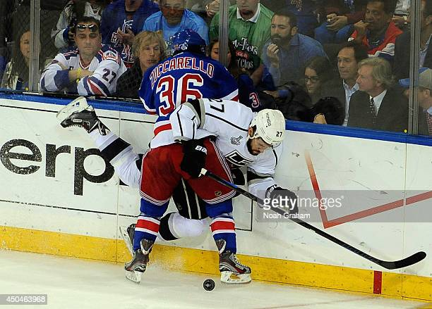Mats Zuccarello of the New York Rangers checks Alec Martinez of the Los Angeles Kings in the third period of Game Four of the 2014 Stanley Cup Final...