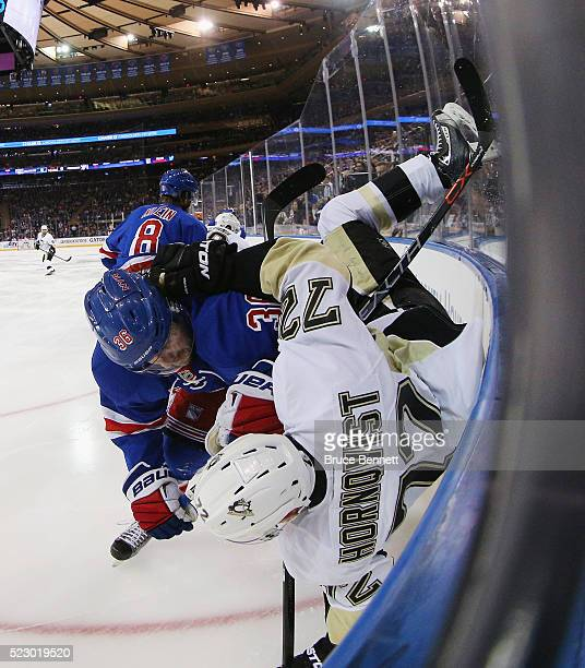 Mats Zuccarello of the New York Rangers flips Patric Hornqvist of the Pittsburgh Penguins during the second period in Game Four of the Eastern...