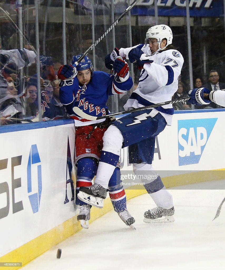 <a gi-track='captionPersonalityLinkClicked' href=/galleries/search?phrase=Mats+Zuccarello&family=editorial&specificpeople=7219903 ng-click='$event.stopPropagation()'>Mats Zuccarello</a> #36 of the New York Rangers is it into the boards by <a gi-track='captionPersonalityLinkClicked' href=/galleries/search?phrase=Victor+Hedman&family=editorial&specificpeople=4784238 ng-click='$event.stopPropagation()'>Victor Hedman</a> #77 of the Tampa Bay Lightning during the second period at Madison Square Garden on January 14, 2014 in New York City.